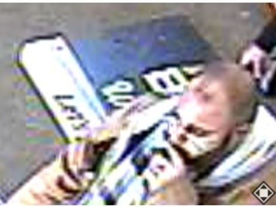 Muncie police released this surveillance video image of the suspect in an attack on a Rural King assistant manager.