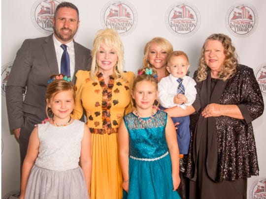 Celebrating with Gabe Brown and Dolly Parton are his whole family,   Kirsten Brown, Kinsley Brown, his wife, Amber Brown, Joseph Brown, and Norma Jean (his mother).