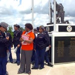 Pat Mason-Guillory conducts a recent tour of the St. Landry Parish Veterans Memorial for students from Northwest High School's JROTC program.