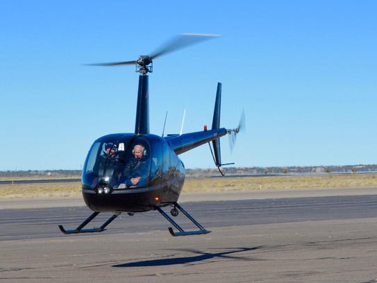 Millionaire Forrest Fenn, right in a hired helicopter,