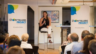 Enquirer reporter Kate Murphy shares her story at the 11th Cincy Storytellers event.