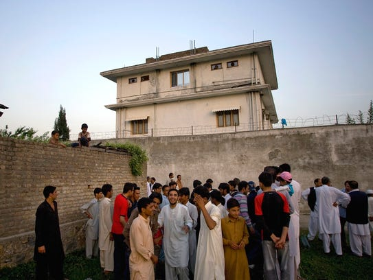 In this May 3, 2011, file photo, local residents gather