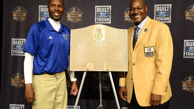 Derrick Brooks shown with Charlie Ward at an event honoring the Washington High graduate for his Pro Football Hall of Fame induction, will be guest speaker June 20 at the Southern League All-Star Game and Hall of Fame Luncheon at Skopelos at New World.