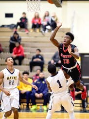 Canton's Vinson Sigmon (13) goes up for the shot as
