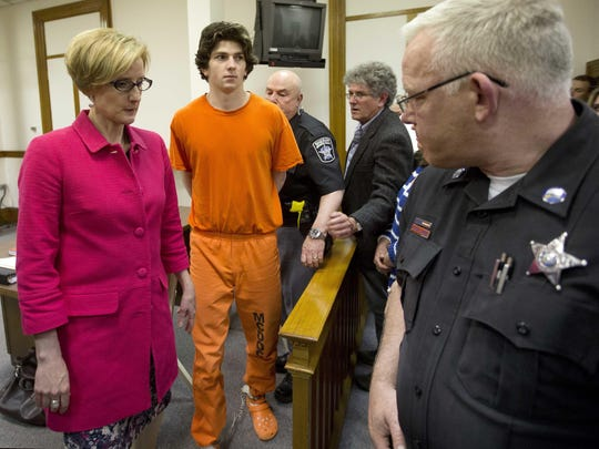 Owen Labrie is escorted out of the Merrimack County Superior Court on Monday, May 16, 2016, in Concord, N.H., after a judge agreed to new bail conditions. Labrie, a prep school graduate convicted of sexually assaulting a 15-year-old freshman girl as part of a game of sexual conquest called Senior Salute, will again be free pending appeal and now required to use electronic monitoring via GPS.