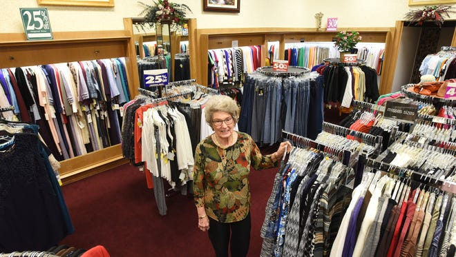 Owner Lynn Weaver stands in Golden's in downtown Coshocton. The combined Golden's and Carton's stores are closing. Golden's was founded in 1913, and Carton's in 1909.