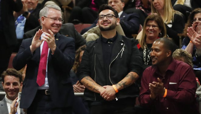 Juan Carlos Montes De Oca (center), is singled out by Gov. Doug Ducey during his 2018 January State of the State speech. Montes De Oca was being investigated by the cosmetology board for giving haircuts to homeless veterans, and Ducey asked that the investigation be stopped.