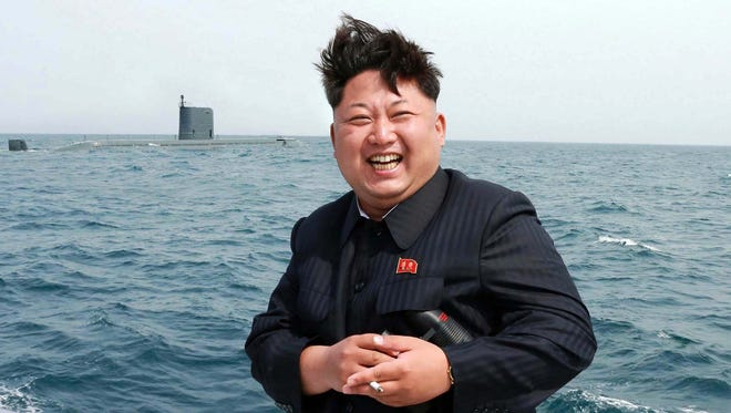 North Korean leader Kim Jong Un observing what the state news agency claimed was an underwater test-fire of a submarine-launched ballistic missile on May, 9, 2015.