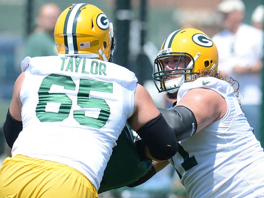Green Bay Packers guard Josh Sitton, right, battles guard Lane Taylor (65) during Organized Team Activities at Clarke Hinkle Field June 10, 2015.