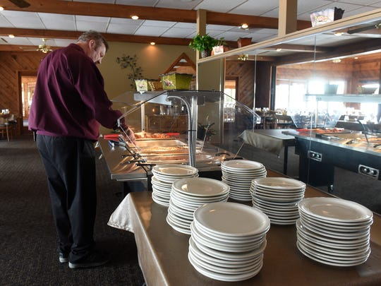 Mike Dols tends to the lunch buffet Wed., Oct. 18, 2017 at The 400 Club.