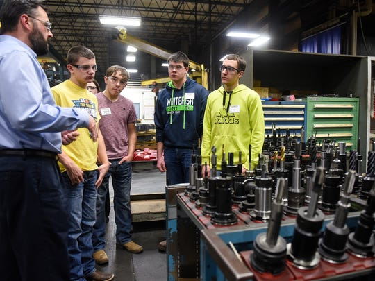 Advanced Manufacturing Engineer Andy Binsfeld explains plant operations during a tour of the Columbia Gear facility Thursday, Dec. 14, in Avon.