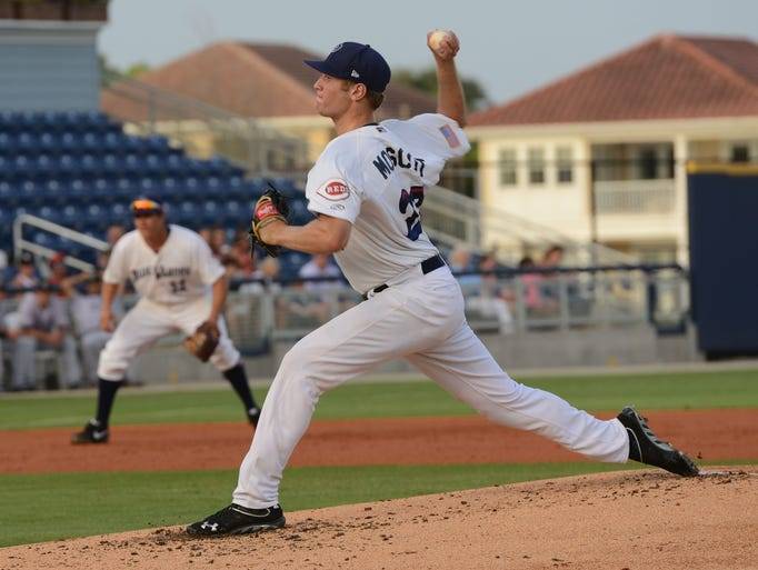 Pensacola Blue Wahoos pitcher Jon Moscot winds up from the mound Monday in a game against the Jacksonville Suns.