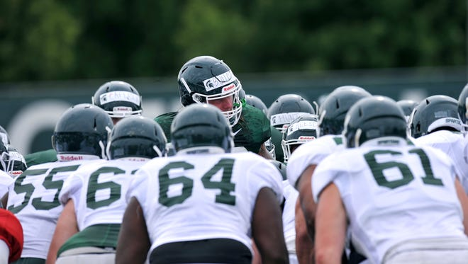 Riley Bullough talks to MSU teammates before practice on Monday.