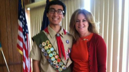 Daniel Feuerstake of Boy Scout Troop 353 in Putnam Valley, shown here being congratulated by County Executive MaryEllen Odell,  recently earned the rank of Eagle Scout.