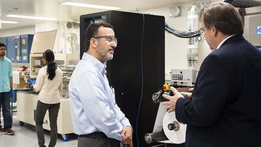 Ali Shakouri, left, director at the Birck Nanotechnology Center, will lead an effort to integrate flexible electronics into pharmaceuticals and smart pills, food packaging and agriculture, and smart wound dressings. The research is part of a $171 million Department of Defense initiative to advance manufacturing of flexible electronics.