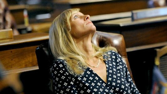 Michigan State Rep. Cindy Gamrat stares at the ceiling before a vote to expel her.