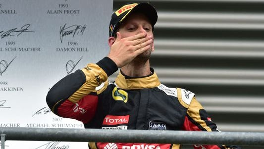 Romain Grosjean celebrates on the podium after finishing third at the Belgian Grand Prix.