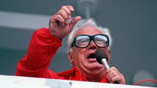 Harry Caray sings 'Take Me Out To The Ballgame,' a tradition that continues at Wrigley Field with guest singers.