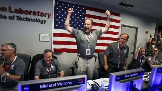 From left, Geoffrey Yoder, Michael Watkins, Rick Nybakken, Richard Cook and Jan Chodas celebrate in Mission Control at NASA's Jet Propulsion Laboratory as the solar-powered Juno spacecraft goes into orbit around Jupiter on Monday in Pasadena, Calif.