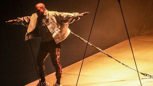 Kanye West balances on an innovative floating stage at Bankers Life Fieldhouse in Indianapolis.