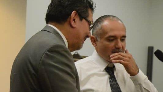 Defense attorney Eusebio Solis, left, talks with Luis Tejada at a December hearing.