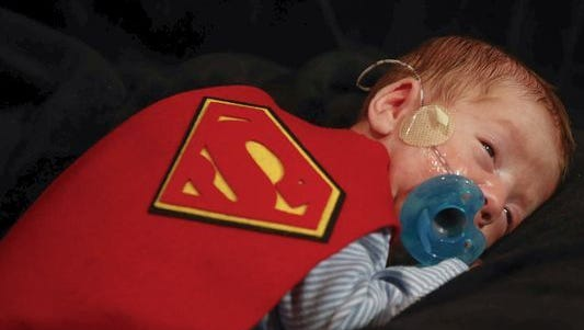 Porter McDonald wears a Superman cape on Thursday, Oct. 26, 2017, at the Neonatal Intensive Care Unit at Mercy Hospital in Des Moines. Thirty-eight babies in the NICU were dressed in Halloween costumes, which were made by one of the nurses on staff.