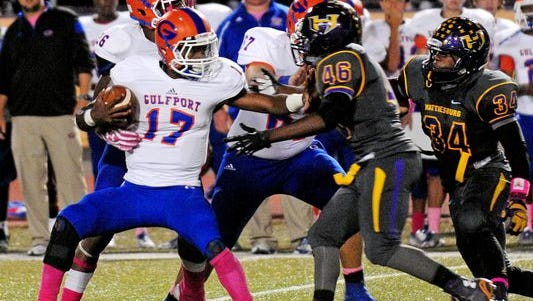 Gulfport quarterback Richaud Floyd (17) tries to break out of the grasp of Hattiesburg's Marcus Pope, Jr. during Friday's game at D.I. Patrick Stadium.