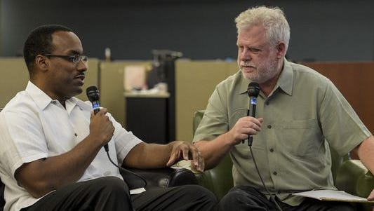 """David Dye, host of NPR's """"World Cafe"""" radio program, right, interviews Herman Fuselier, music and entertainment reporter of the Daily Advertiser, in 2014."""