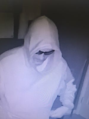Police are investigating a burglary that occurred at the Cocoa Country Inn, 1518 E. Chocolate Ave., Hershey, on June 6, 2017 at approximately 12 a.m.. Video footage from the business shows a white male wearing a white hooded jacket and black pants enter the office facility. The male also appears to have facial hair, and was wearing black glasses. The suspect was then seen taking a deposit safe from the office and concealing it before fleeing the area. Police are asking for assistance in identifying the male subject. Anyone with information is asked to contact the Derry Township Police Department at 717-534-2202.