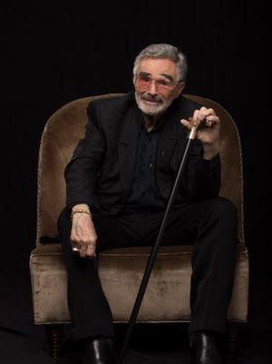 "Burt Reynolds shows the movie-star smile posing for ""The Last Movie Star."""