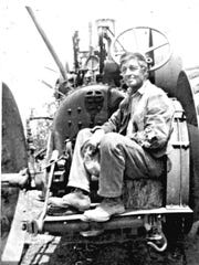 John Funkhouser with a traction mill, which he drove from Missouri to Baxter County before 1939.