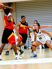 Adonis Flores' granddaughter Alina Bonto guards an opponent at the 2015 Pacific Games in Papua New Guinea. Bonto was the 2013 IIAAG MVP of the high school girls' basketball team and played on the Guam women's national basketball team.
