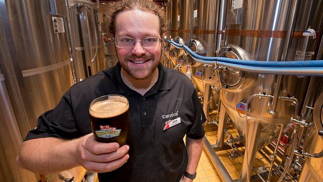 Colin Presby, brewmaster of the RedFrog Pub & Brewery on Carnival Cruise Line's new Carnival Vista, poses in the brewery's fermenting room.