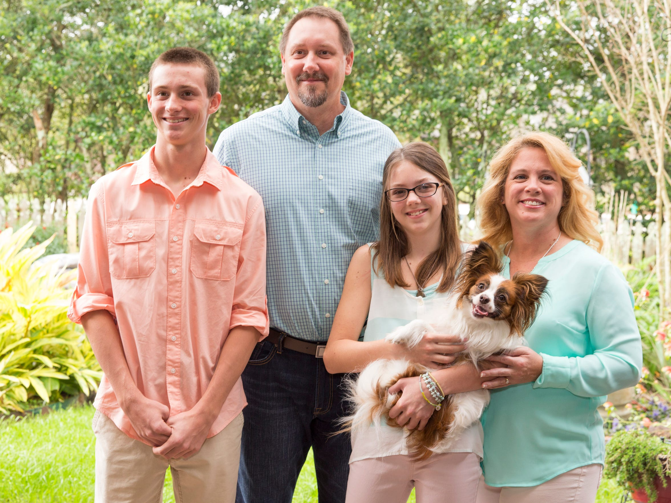 "Kacie Francois, the Leukemia & Lymphoma Society's ""Girl of the Year"" with her family: brother  Jacob, father, Kevin, mother, Sonya, and dog, Hope, at their home in Lafayette on March 16."