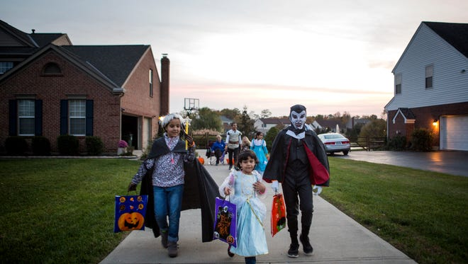 Dalal, Rimas and Hussein Alhamoud go trick-or-treating with their siblings for the first time Monday, October 31, 2016.