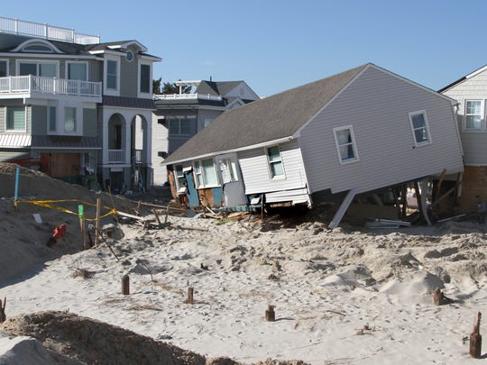 A collapsed home sits on dunes on Long Beach Island at 82nd Street after superstorm Sandy.