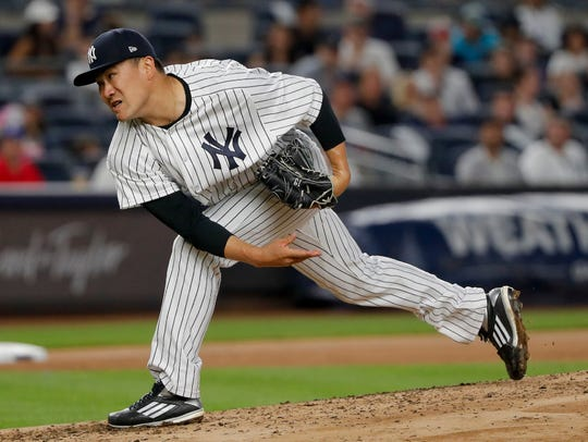 Masahiro Tanaka delivers a pitch against the Rangers