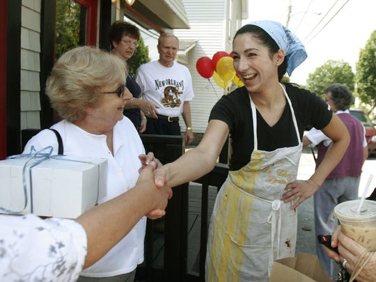 Gesine Prado, center, greets customers at the opening of her bakery, Gesine's Confectionary, in Montpelier, Vt., Tuesday, Aug. 2, 2005. Crowds lined up for the grand opening of the bakery Tuesday to get complimentary macaroons from actress Sandra Bullock, Prado's sister.