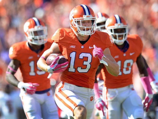 Clemson wide receiver Adam Humphries (13) returns a Louisville punt 72 yards for a TD during the 1st quarter Saturday, October 11, 2014 at Clemson's Memorial Stadium.