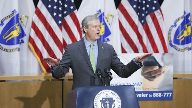 Gov. Charlie Baker speaks Friday at a Boston press conference, where he said he was authorizing all state and local police to enforce his new orders limiting social gatherings.