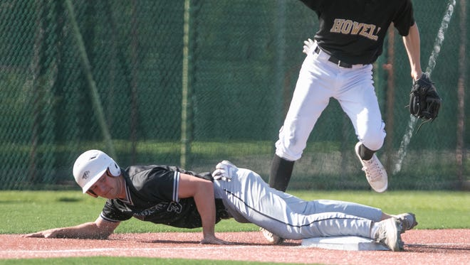 Plymouth's Chase Every was safe on a steal of third base, causing Howell third baseman Evan Mazer to stumble over him in the KLAA Championship game Wednesday, May 23, 2018.