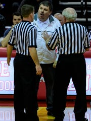 Bosse Head Coach Shane Burkhart disagrees with a foul called on his team during the third quarter against the Memorial Tigers at Bosse High School in Evansville, Ind., Tuesday, Dec. 12, 2017. The Bulldogs defeated the Tigers, 85-59.