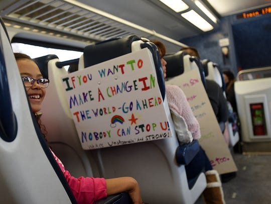 Eden Hamlin, age 8, of Glen Rock takes the train to