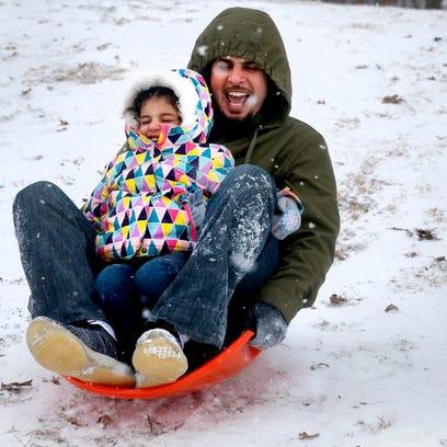 Saleh Alarifi,  slides down a hill at Barfield Park