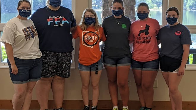 On July 8-10, Union Local FFA members, Alyssa and Sierra Betts, Faith Galavich, Cheyenne Dallas, and Charlee Daughtery went to FFA camp. They had the opportunity to meet the new Ohio FFA state officer team. Normally, over 200 kids attend each of the five sessions of summer FFA camps at Ohio FFA Camp Muskingum and this year there was only one session due to COVID-19. The students attended two workshops with the officers, did some activities including archery, kayaking, hanging out with the animals in the nature center and more. Campers left items in a time capsule at camp to remember and look back on this special year. They were very grateful to have this opportunity. Pictured, l to r, are Mrs. Baker, Faith Galavich, Cheyenne Dallas, Sierra Betts, Alyssa Betts, Charlee Daugherty.