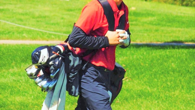 Pekin golfer Dawson Woll walks away from the 18th hole at Lick Creek Golf Course on Saturday after shooting a 14 on the hole. His fortunes were about to change.