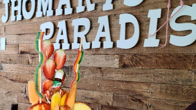 Jhomary's Paradise, an eatery featuring Mexican snack foods, opened Wednesday, Dec. 23. The business is located in Washington Square in the former storefront of Nefty's Barber Shop.