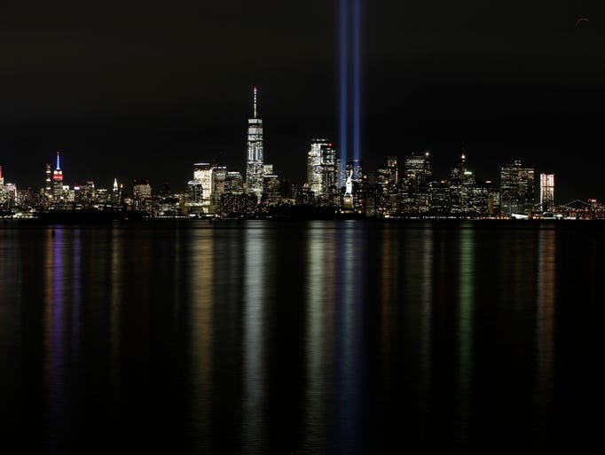 The Tribute in Light rises over the New York City skyline