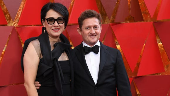 Alex Winter, right, and Ramsey Naito, the writers of