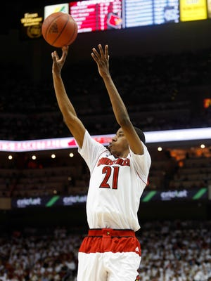 Louisville's Shaqquan Aaron nails a three from the corner against North Carolina. Jan. 31, 2015